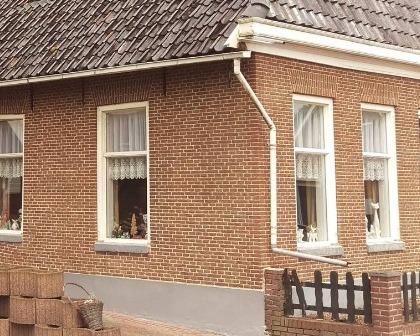 Restauratie gevel en reinigen woonboerderij